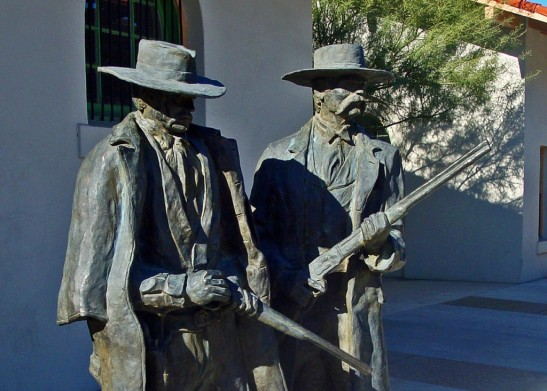 Life-size statues of lawman Wyatt Earp and deputy Doc Holliday at the Historic Railroad Depot