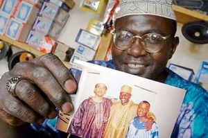 Obama's Brother Holds Family Photo Of Barack In East Kenya