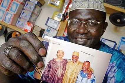 Where there's smoke there's fire! - Malik Obama Holds The Photo Of Barack Hussein Obama His Brother.