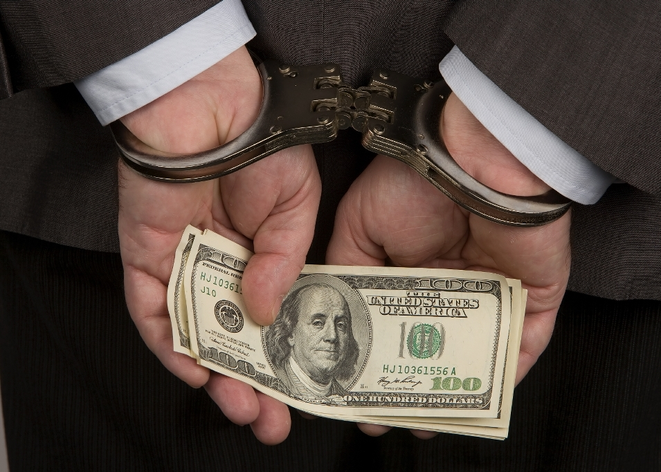 madoff-handcuff-money