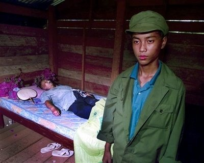 The body of Khmer Rouge leader Pol Pot lies on a mattress in a small hut near the Thai-Cambodia border about a mile from Chong Sangam Pass, Thailand, Thursday, April 16, 1998, in this file photo. Pol Pot died on April 15, 1998, the leader of the Khmer Rouge who was responsible for the deaths of about 1.7 million of his countrymen.