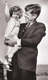 Last Free President Of The United States: President John F. Kennedy and daughter Caroline, 2 in Hyannisport, MA 5/23/60