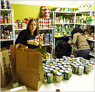 People rely on food banks, like the Community Food and Outreach Center in Orlando, Fla.