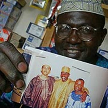 in laden illuminati. Obama#39;s brother Malik holds a photo of his younger muslim brother Obama and a friend in