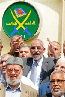 Egyptian Muslim brotherhood leader Mohammed Badie waves to journalists during a news conference to announce the head of the new Muslim Brotherhood party in Cairo, April 30, 2011. REUTERS/Mohamed Abd El Ghany