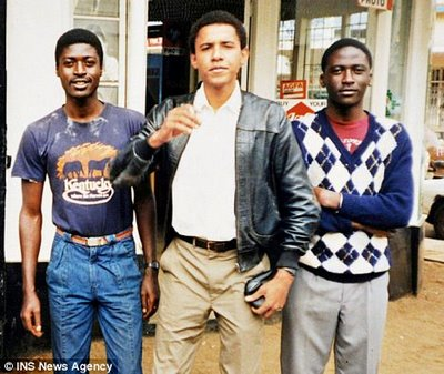 Obama's pedophile brother in t-shirt -his name is samson obama, he was barred from entering the U.K.