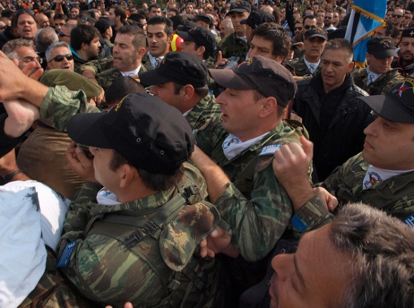 Its Happening In Greece Too! Greece Military High Fives Fellow Citizen Fighting Banker's Crime Of Austerity.