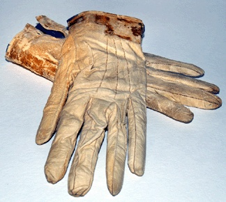 Leather gloves worn by Lincoln to Ford's Theater on the night of his assassination. Blood stains are visible at the cuffs.
