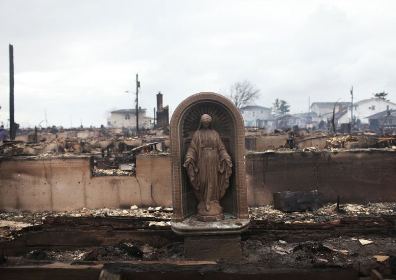 A Virgin Mary is all that remains from a home which was destroyed during Hurricane Sandy October 30, 2012 in the Breezy Point neighborhood of the Queens borough of New York City.