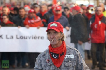 Belgian workers take part in a demonstration during an European strike in La Louviere