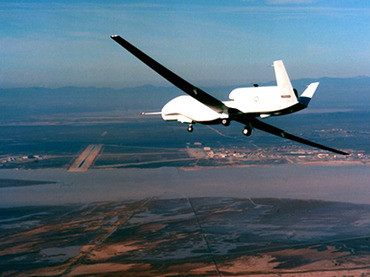 In The U.S. The Global Hawk, the Department of Defense's newest reconnaissance aircraft, flies over Edwards Air Force Base, CA, 28 February, 1998, during its first flight.  US forces have deployed the Global Hawk, a new high-flying unmanned reconnaissance spy plane, to join the hunt for Osama bin Laden in Afghanistan, despite testing of the aircraft being incomplete.  Operating at heights above 60,000 feet (18,200 meters), the Global Hawk is intended as a fast reaction strike system designed to hit targets within five minutes of their detection.        AFP PHOTO