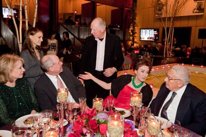Rothschild standing and Kissinger sitting.