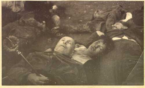"Mussolini's final rest on his Mistress's breast.The Leader is posed, holding his scepter and wearing a coat.  Condition of the bodies verifies this ""pose"" was taken prior to the 7 being hung up and beaten."