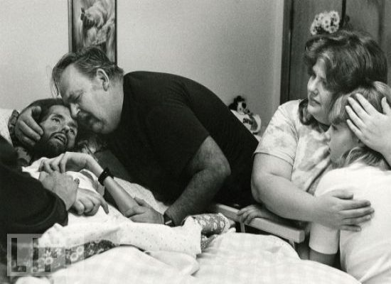 AIDS sufferer David Kirby is embraced by his father