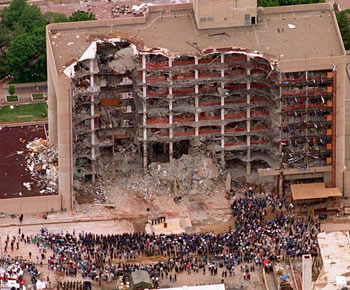 Search and rescue crew members attend a memorial service in front of the Alfred P. Murrah Federal Building in Oklahoma City on May 5, 1995.