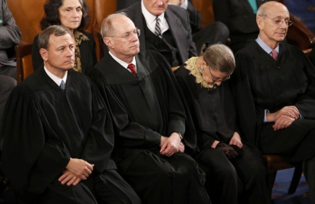 Supreme Court Justice Ruther Bader Ginsburg had trouble keeping her head up during the State of the Union speech. The 79-year-old was sitting with her fellow justices and stood out for the ornate neck element she adds to her black robe, along with her lacy black gloves. (Jason Reed/Reuters)