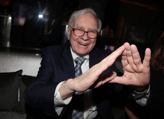 America's Hemorrhoid Warren Buffet Displaying The NWO Symbol Of The Illuminati Banker's Boys Club..