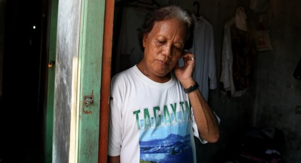 """Barack Obama's """"transgender ex-nanny"""" In this Friday, Jan. 27, 2012 photo, Evie, also known as Turdi, the former nanny of U.S. President Barack Obama, stands at the doorway of her room at a boarding house in a slum in Jakarta, Indonesia. Evie, who was born a man but believes she is really a woman, has endured a lifetime of taunts and beatings because of her identity. Nobody knows how many transgenders live in the sprawling archipelagic nation of 240 million, but activists estimate 7 million. However, societal disdain still runs deep - when transgenders act in TV comedies, they are invariably the brunt of the joke. (AP Photo/Dita Alangkara)"""