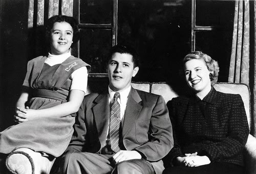 1,956: Ann appears to be around 14 years old, so this is maybe 1956. Left to right: Ann Dunham (1942-1995), Stanley Armour Dunham (1918-1992), and wife Madelyn Lee Payne (1922)