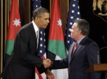 FILE - In this March 22, 2013, file photo, President Barack Obama, left, and Jordan's King Abdullah II, right, shake hands following their joint new conference at the King's Palace in Amman, Jordan