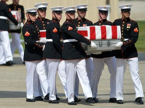 Marines bring a son home to his mother.