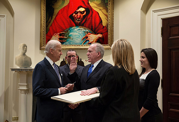 Zionist Brennan being sworn in by zionist Biden
