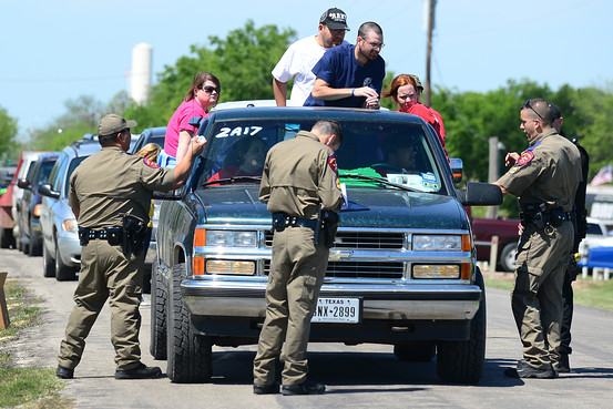 Texas Highway Patrol officers took down the details and marked the vehicles of residents being allowed to return to their destroyed homes near the site of the blast. Getty Images