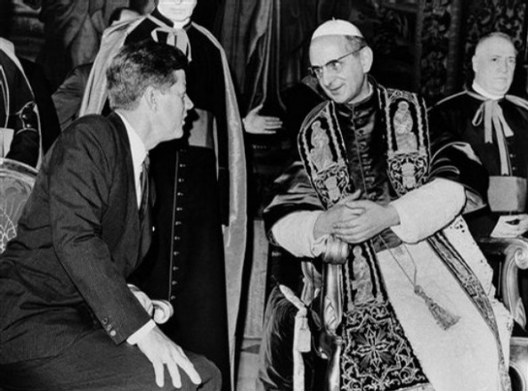 Pope Paul VI ** FILE ** President John F. Kennedy and Pope Paul VI talk at the Vatican in this July 2, 1963 file photo. Kennedy's meeting with Pope Paul VI at the Vatican was historic: the first Roman Catholic president of the United States was seeing the Roman Catholic pontiff only days after his coronation. Kennedy _ who struggled against anti-Catholic bias during his presidential campaign _ only shook hands with the pope rather than kissing his ring, as is the usual practice for Catholics.  (AP Photo/File)