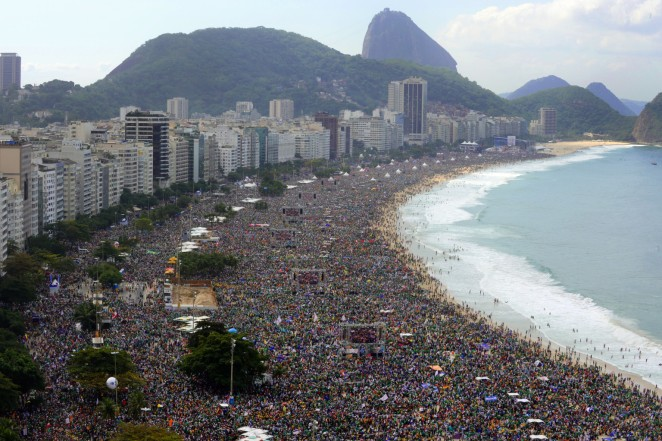 Hundreds of thousands of people crowd Copacabana beach in Rio de Janeiro on July 28, 2013 as Pope Francis celebrates the final mass of his visit to Brazil. Throngs of pilgrims attending World Youth Day (WYD) spent the night sleeping on the beach before Sunday's final mass, while the city's mayor said he expects up to three million people to pack the beach for the occasion.   AFP PHOTO / TASSO MARCELO        (Photo credit should read TASSO MARCELO/AFP/Getty Images)