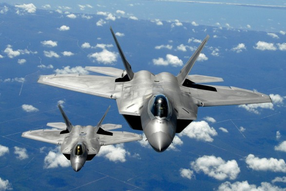 Two Air Education Training (AET) F-22 Raptor from Tyndall Air Force Base, fly in trail behind a KC-135R Stratotanker from the 151st ARS McGhee Tyson ANG, TN after refueling during a training mission (U.S. Air Force photo by Senior Master Sgt. Thomas Meneguin)