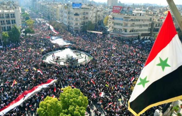 America, out, out, Syria will stay free'; chanted a million-strong march in Damascus on Wednesday