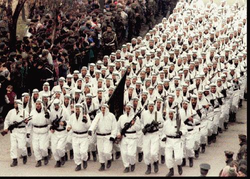 Bosnian Muslim Army troops of the Al-Qaeda linked El Mujahedeen Unit parade in downtown Zenica in central Bosnia in 1995, carrying the black flag of Islamic jihad.