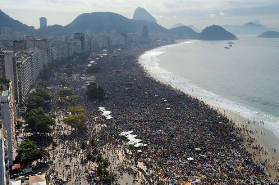 Three million people gather on Rio beach for mass with Pope Francis.