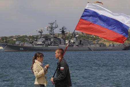 Russia Cracks Down On Obama's NWO Running Wild: Warns The NWO Rothschild Controlled U.S. Military & NATO. Large_girlflagcrimean_tinderbox_meye