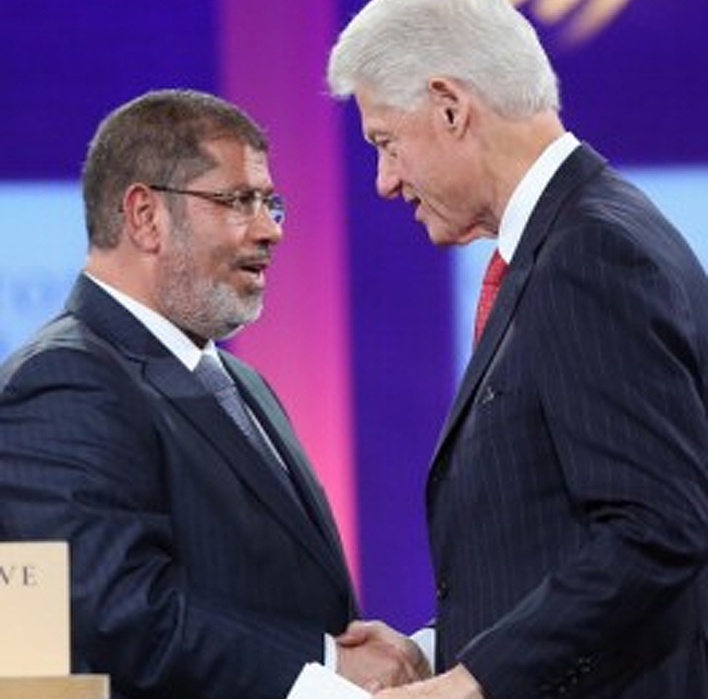 Overthrown illuminati goon Mohamed Morsi of Egypt's Obama Muslim Brotherhood & Clinton. Morsi is now in prison in Egypt for murder and inciting violence.