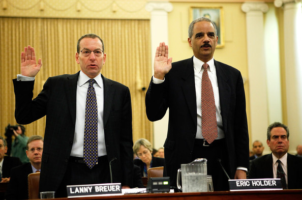 U.S. Attorney General Eric Holder (R) and Assistant Attorney General Lanny Breuer of the Criminal Division (L) are sworn in during a hearing before the Financial Crisis Inquiry Commission January 14, 2010 on Capitol Hill in Washington, DC. The commission continued its hearing to examine the root causes of the recent financial crisis and how now to prevent it in the future.