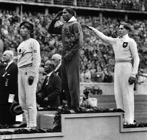 Snubbed: American sporting hero Jesse Owens taking gold at the Berlin Olympics in 1936 after Hitler claimed he had been humiliated by a 'sub-human'.
