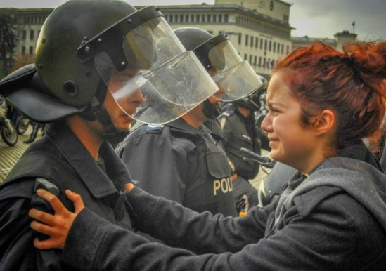 This powerful photo of a student protestor and a police officer crying has gone viral in Bulgaria.