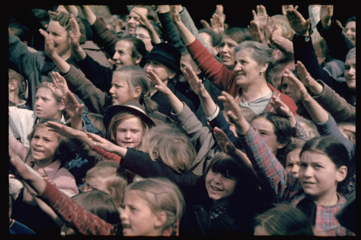 Happy and excited crowds saluting Germans at Schwarzach/St. Veith during Hitler's Austrian election campaign.