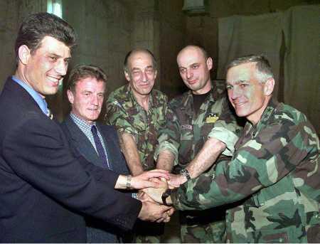 KLA leader Hashim Thaci, Viceroy Bernard Kouchner, General Sir Michael Jackson, KLA commander Agim Ceku, and General Wesley Clark celebrate the victory of their joint enterprise; Pristina, 1999