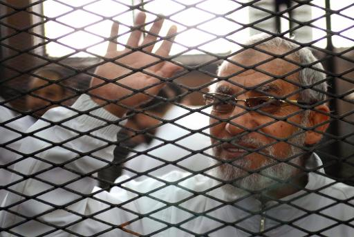Ahmed Gamil/AFP/File Egyptian Muslim Brotherhood leader Mohamed Badie waves from inside the defendants cage during the trial of Brotherhood members, near Cairo Turah prison.