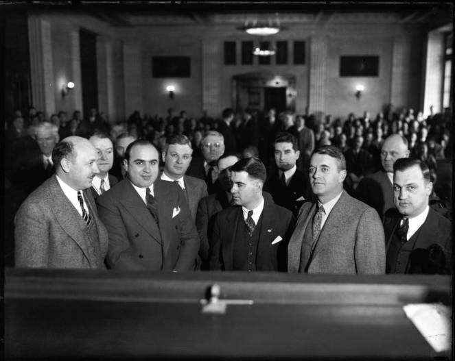 Al Capone, second from left, in Chicago's criminal courthouse in 1931. — Chicago Tribune historical photo