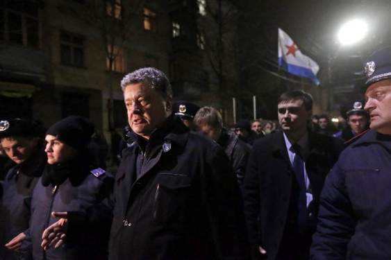 Pro-Eastern Ukrainians recognize the Kiev Western Coup As An Act Against Ukraine's Constitution, force Western Ukrainian Petro Poroshenko out of Crimea's parliament building in Simferopol on Feb. 28, 2014