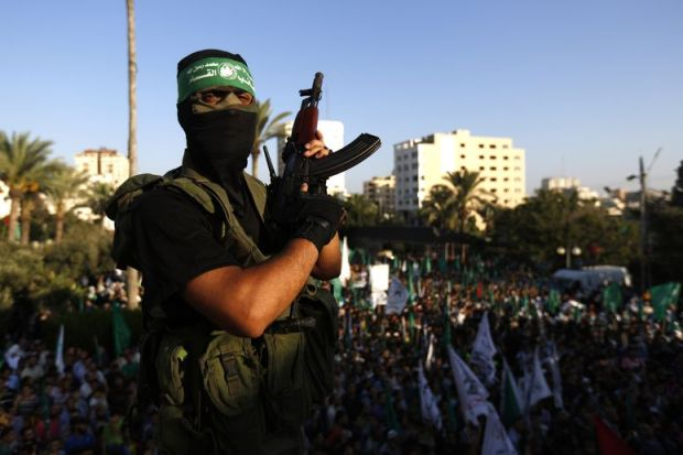 Hamas fighter at a post-ceasefire rally. Mohammed Abed /AFP/Getty Images