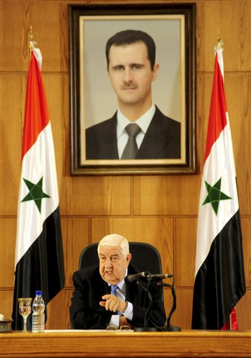 Syrian official news agency SANA, Syrian Foreign Minister Walid al-Moallem speaks during a press conference, giving the first public comments by a senior Assad official on the threat posed by the Islamic State group, in Damascus, Syria on Monday, August 25, 2014. Al-Moallem warned the U.S. not to conduct airstrikes inside Syria against the Islamic State group without Damascus' consent, saying any such attack would be considered an aggression. Al-Moallem also said that Syria is ready to work with regional states and the international community amid the onslaught of Islamic militants there and in Iraq, adding that the Syrian government is a crucial partner in the war on terror.