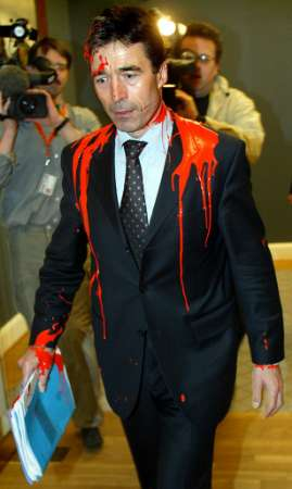 NATO's Zionist Anders Rasmussen Attacked With Red Paint