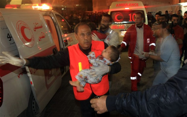 Palestinian medics carry a wounded baby into the Al-Shifa hospital in Gaza City following an Israeli air strike.