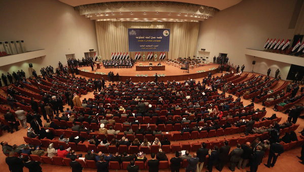 Iraqi lawmakers attend a session to approve the new government in Baghdad, Iraq.