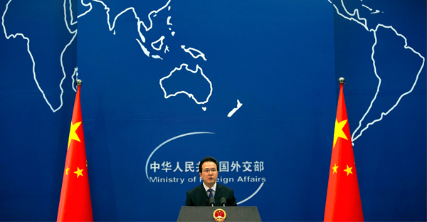 Foreign Ministry spokesman Hong Lei speaks during a daily briefing at the Ministry of Foreign Affairs office in Beijing