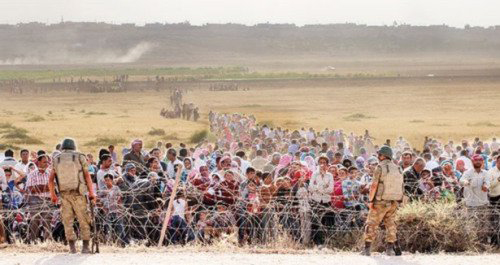Turkish Brotherhood soldiers block Syrian refugees at border near Kobani.  Turkey and the U.S. are cynically using the Kurdish people as a bargaining chip in a strategy of conquest against Syria's Sovereignty.